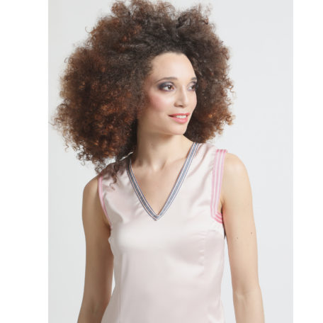 V collar of the silk pink asymmetrical dress